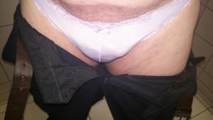 Wearing her sissy panties to work like a good girl!